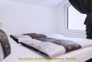 A bed or beds in a room at Winterberg Citylife
