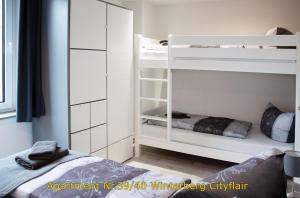 A bunk bed or bunk beds in a room at Winterberg Citylife
