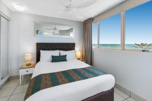 A bed or beds in a room at Sandcastles Mooloolaba