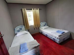 A bed or beds in a room at Hillside Villa