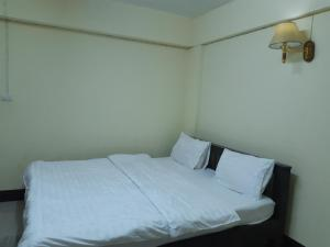 A bed or beds in a room at The First Resident Lamphun