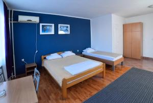 A bed or beds in a room at Hostel Milkaza