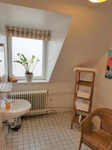 Ein Badezimmer in der Unterkunft Hotel Flora