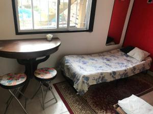 Una cama o camas en una habitación de Alojamiento Magic