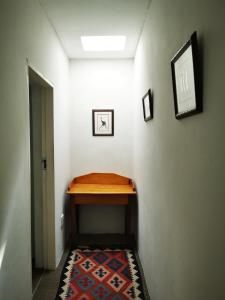 A bed or beds in a room at Meintjieskop Guest House
