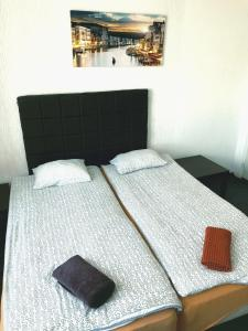 A bed or beds in a room at Rooms Latberry