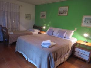 A bed or beds in a room at Quinta dos Janssen, a sua casa na Serra Gaúcha