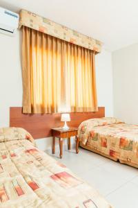 Cama o camas de una habitación en Hotel del Rey