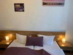 A bed or beds in a room at Pension Belo Sono