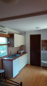 A kitchen or kitchenette at XeniCamp & Bungalows