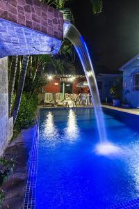 The swimming pool at or near Pousada Porto do Itagua