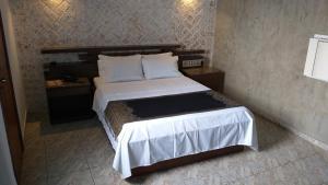 Cama ou camas em um quarto em Millenium Hotel