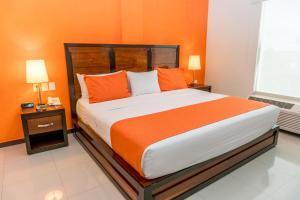Cama o camas de una habitación en Comfort Inn Cancún Aeropuerto