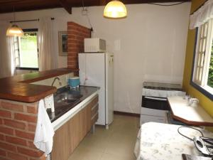 A kitchen or kitchenette at Hotel Vivenda Penedo