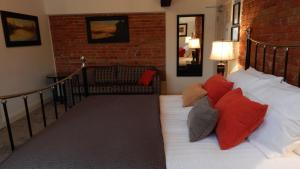 A bed or beds in a room at The George at Baldock Boutique Hotel