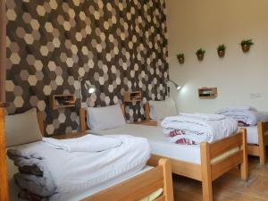 A bed or beds in a room at Envoy Hostel