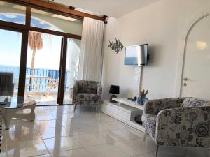 A television and/or entertainment center at Pissouri Beach Front Apartments
