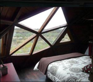 Una cama o camas en una habitación de El Portal de Orion
