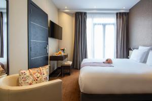 A bed or beds in a room at Albert 1er