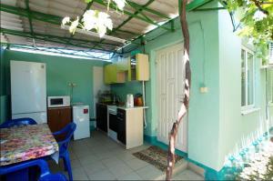 Кухня или мини-кухня в Гостевой дом Барбарис