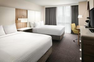 A bed or beds in a room at Crowne Plaza Dallas Market Center
