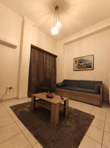 A seating area at Apartment @Katehaki Metro