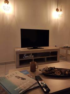 A television and/or entertainment centre at Apartment @Katehaki Metro