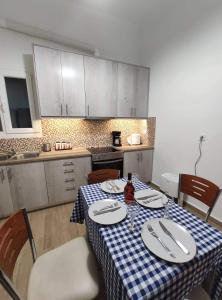 A kitchen or kitchenette at Apartment @Katehaki Metro