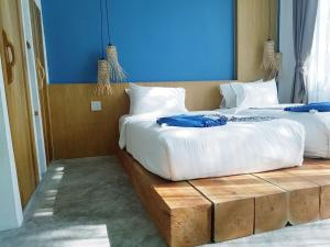 A bed or beds in a room at In Touch Resort