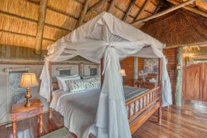A bed or beds in a room at Mbali Mbali Soroi Serengeti Lodge