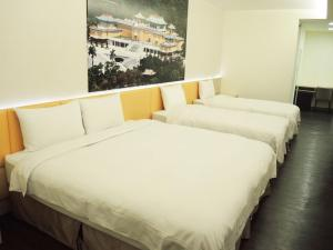 A bed or beds in a room at C U Hotel Taipei