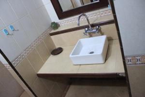 Ein Badezimmer in der Unterkunft Jambu Inn