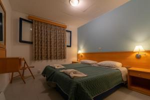Ένα ή περισσότερα κρεβάτια σε δωμάτιο στο Govino Bay