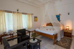 Кровать или кровати в номере Zerof Guest House