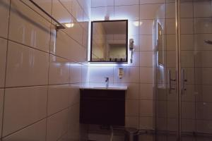 Ett badrum på Liljeholmens Stadshotell