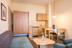 A kitchen or kitchenette at AktiVital Hotel