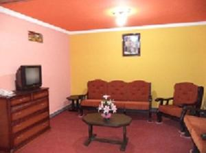 A seating area at Apart Hotel Turquesa