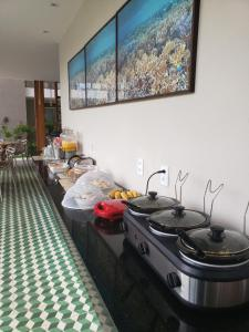 A kitchen or kitchenette at Pousada Ricoco