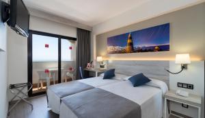 Säng eller sängar i ett rum på Medplaya Hotel Bali