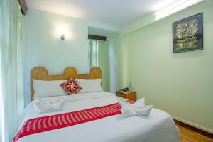 A bed or beds in a room at Pilgrims Guest House