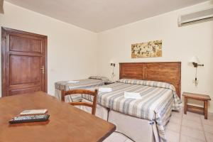 A bed or beds in a room at Hotel Villa Rodriguez