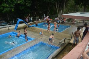 The swimming pool at or near Cascatinha Park Hotel