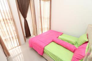 A bed or beds in a room at Villa Holiday by Masterpiece Villa