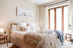 A bed or beds in a room at Apartamento en Baqueira cota 1700 con garaje y wifi