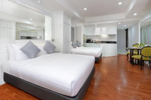 A bed or beds in a room at Centre Point Silom