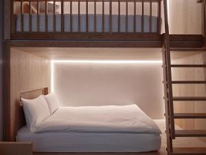 A bed or beds in a room at Zedwell Piccadilly