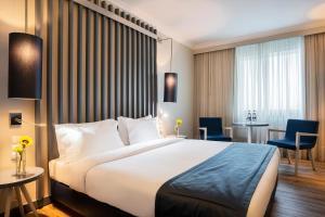 Cama ou camas em um quarto em HF Ipanema Park