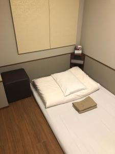 A bed or beds in a room at Hotel Meldia Osaka Higobashi