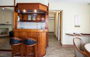 A kitchen or kitchenette at La Residence Itaim by Manager