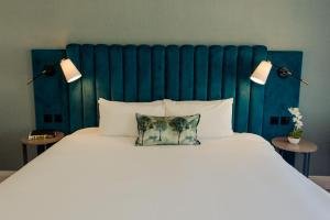 A bed or beds in a room at Tulfarris Hotel and Golf Resort